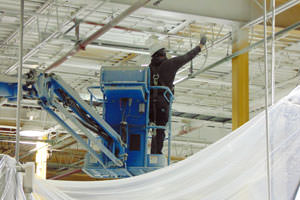 spray painting steel ceiling structures at a Goshen, Indiana facility