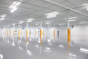 industrial painting of ceiling, walls, beams & epoxy floor in Erie factory