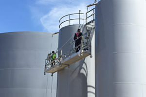 painters spray painting steel storage tanks, Farmington Hills, MI