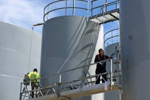 workers spray painting exterior tanks in Massillon, Ohio