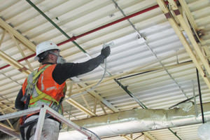 spray painting of a factory ceiling by a Detroit Michigan painting contractor