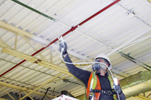 painting underway of metal ceiling by a Lansing MI painting contractor
