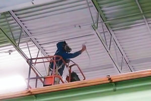 painting a metal ceiling by a Warren, MI industrial painter