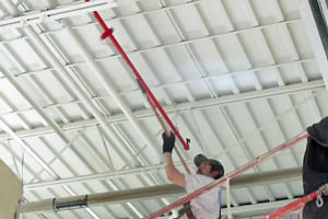 industrial painter painting pipes in Troy, MI